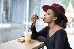 Beautiful girl in cafe Stock Photography