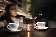 Beautiful girl in a cafe. Having a cup of coffee at a dinner Royalty Free Stock Photo