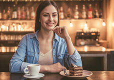 Beautiful girl at the cafe. Beautiful girl is looking at camera and smiling while sitting at the cafe Royalty Free Stock Image