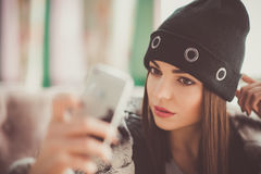 Beautiful girl in a cafe photographing themselves Royalty Free Stock Photography