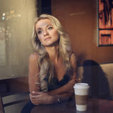 Beautiful girl at the cafe waiting for the date Stock Photos