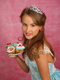 The beautiful girl with a cake Stock Photography