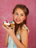 The beautiful girl with a cake Stock Photos