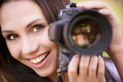 Beautiful girl with camera stock photos