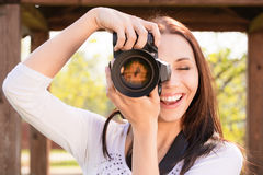 Beautiful girl with camera Stock Photo