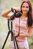 Beautiful girl with camera Stock Image