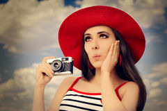 Beautiful Girl with Camera on Blue Sky Royalty Free Stock Photo