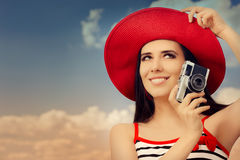 Beautiful Girl with Camera on Blue Sky Stock Images