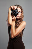 Beautiful girl with camera.Pretty woman is a professional photographer Stock Photography