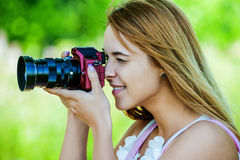 Beautiful girl with camera Stock Photo
