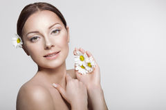 Beautiful Girl With Camomile Flowers. Beauty Woman Face. Perfect Skin. Professional Make-up.Makeup Stock Photos