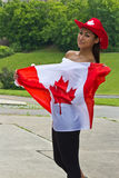 Beautiful girl with a Canada flag Stock Image