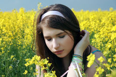 Beautiful girl at canola Stock Images