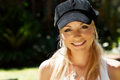 The beautiful  girl in a cap Stock Images