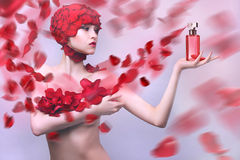 Beautiful girl with a cap of rose petals Royalty Free Stock Photo