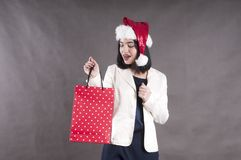 Beautiful girl cap santa shopping bag cute Stock Photo