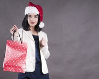 Beautiful girl cap santa shopping bag Royalty Free Stock Images