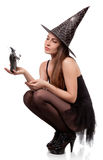 Beautiful girl in a cap of the witch Stock Image
