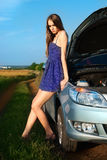 Beautiful girl in the car broke down on a country Royalty Free Stock Images