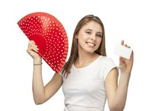 Beautiful girl with card and red fun. On a white background Stock Photos