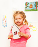 Beautiful girl with cardboard white doll house Royalty Free Stock Images