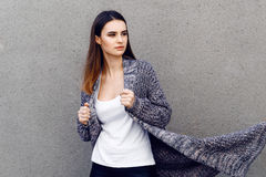 Beautiful girl in a cardigan and shirt outdoor Stock Photo