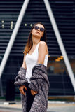 Beautiful girl in a cardigan, shirt and sunglasses outdoor Stock Images