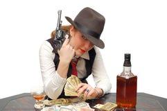 Beautiful girl with cards and gun Stock Photos