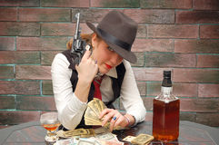Beautiful girl with cards and gun Royalty Free Stock Photo