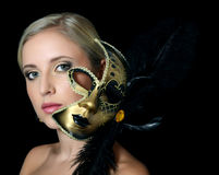 The beautiful girl in carnival mask Stock Image