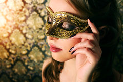 Beautiful girl in carnival mask Royalty Free Stock Images
