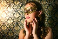 Beautiful girl in carnival mask Stock Image