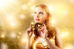 Beautiful girl in carnival mask Stock Photography