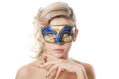 The beautiful girl in carnival mask Stock Images