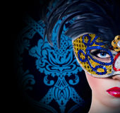 Beautiful girl in carnival mask with red lips Stock Image