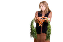 Beautiful girl with carrot royalty free stock image
