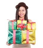 Beautiful girl carrying a lot of gifts Stock Photography