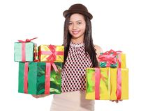 Beautiful girl carrying a lot of gifts Royalty Free Stock Photos