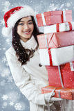 Beautiful girl carrying many presents Royalty Free Stock Photo