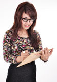 A beautiful girl carrying a pen and notepad Stock Photos
