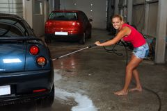 Beautiful girl carwashing Royalty Free Stock Photo