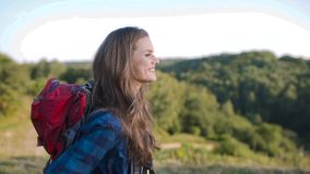 Beautiful girl traveling with bag, hiking in nature. Beautiful girl in casual clothes traveling with colorful bag, hiking in nature on weekend stock video footage