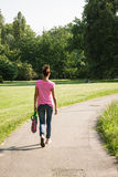 Beautiful girl with casual look walking Royalty Free Stock Image