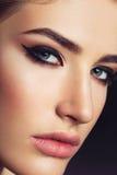 Beautiful girl with cat eye make-up Stock Photos