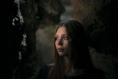 Beautiful girl in a cave with a deep look Stock Photography