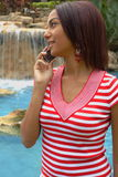Beautiful Girl on A Cell Phone. Beautiful hispanic Girl Talking On A Cell Phone Royalty Free Stock Images