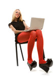Beautiful girl in chair with laptop Stock Photo