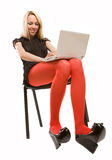 Beautiful girl in chair with laptop Royalty Free Stock Image