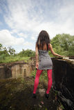 Beautiful girl at a chasm. The girl costing on edge of an old sluice, a kind from a back Royalty Free Stock Photo