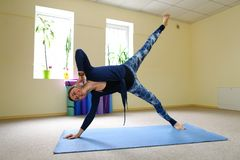 Businesswoman studies basic yoga exercises on online course. stock image
